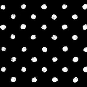 White dots on black