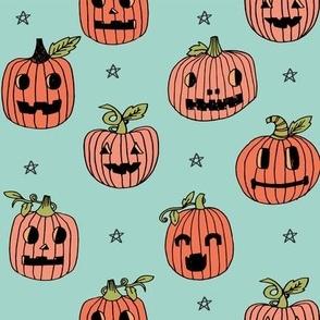 Jack-o'-lantern halloween cute pumpkin carving hand drawn pattern light blue by andrea lauren