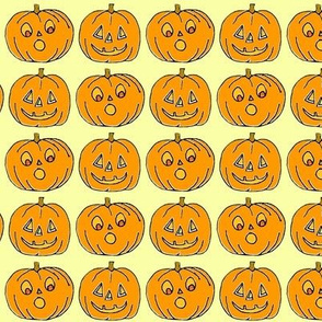 Jack o lanterns on light bright yellow