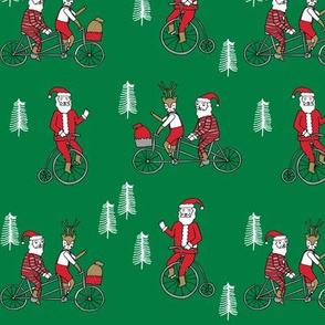 Santa Claus bicycle with reindeer christmas fabric green