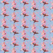 Small birds on soft blue