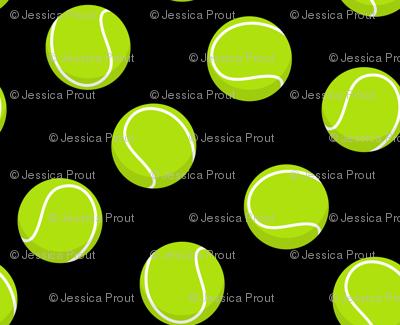 tennis balls on black
