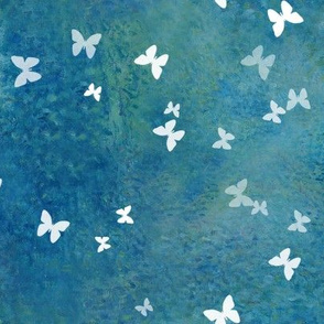 Small white butterflies on blue green