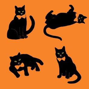 black cats on orange Halloween