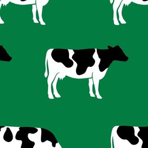 large scale - cows on green