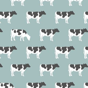 cows on dusty blue