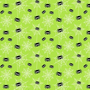 tiny spiders and webs on lime green » halloween