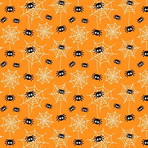 tiny spiders and webs on orange » halloween