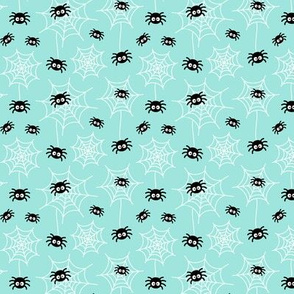 tiny spiders and webs on light baby teal blue » halloween