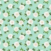 White roses on green