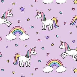 unicorns with rainbows (pastel) on purple