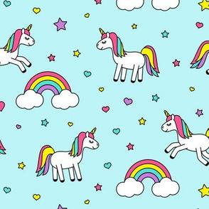unicorns with rainbows (bright) on blue