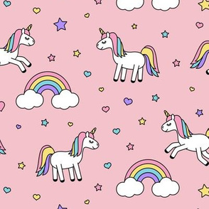 unicorns with rainbows (pastel) on pink