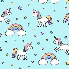unicorns with rainbows (pastels) on blue