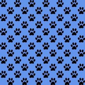 Half Inch Black Paw Prints on Cornflower Blue