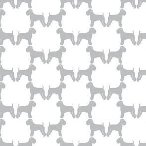 Border Terrier in gray on white