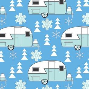 winter trailers on blue