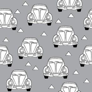 white vintage cars on grey