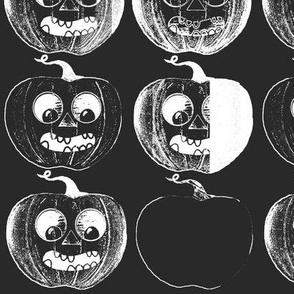 Black and white Jack o lanterns on black