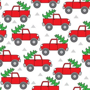 red trucks and christmas trees