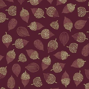 red acorns on burgundy