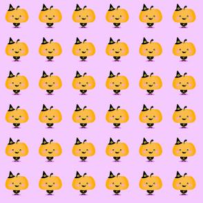 Halloween pumpkin in witch costume