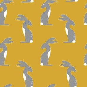 Grey and white hares on mustard yellow