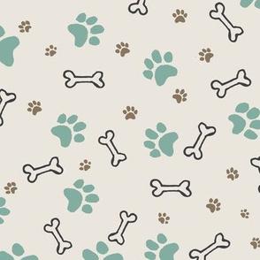Dog paw prints and dog bone