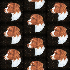 Brittany spaniel on metal relief