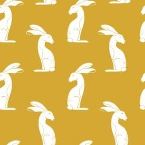 White rabbits on mustard yellow