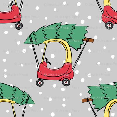 kids car with Christmas tree on grey w/ snow