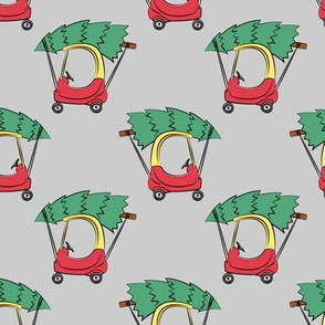 Kids car with Christmas tree on grey