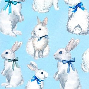 White rabbits on blue background