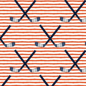 hockey sticks on stripes  - dark orange