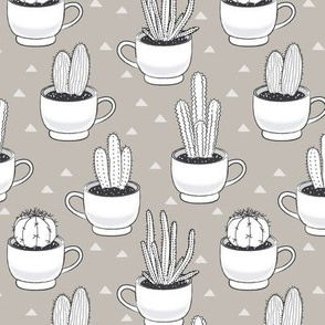 white cactus-in-teacups-on-linen
