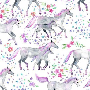 Mom and baby unicorns with pastel manes and tails on white