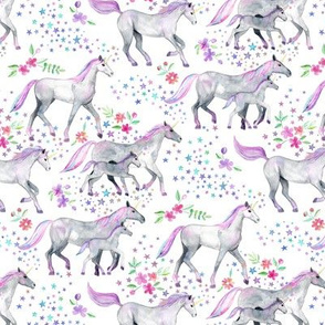 Tiny Mom and baby unicorns with pastel manes and tails on white