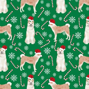 Akita dog breed christmas peppermint sticks candy canes fabric green