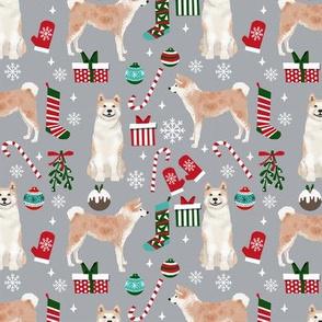 Akita dog breed christmas presents  candy canes snowflakes fabric grey