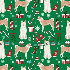 Akita dog breed christmas presents  candy canes snowflakes fabric green