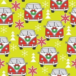 vintage red christmas camper vans on lime green