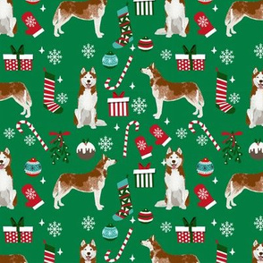 Husky red coat christmas presents candy canes stockings holiday dog fabric green