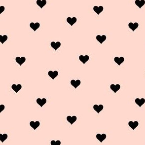 Random black hearts on blush peach