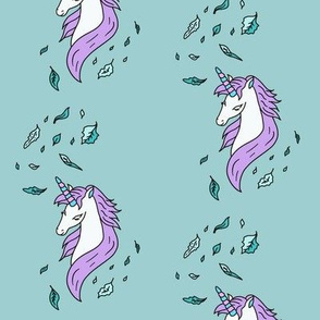 Unicorn-with-Leaves-on-Teal-background