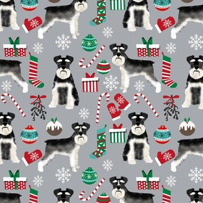 Schnauzer black and white christmas presents stockings candy canes winter fabric grey