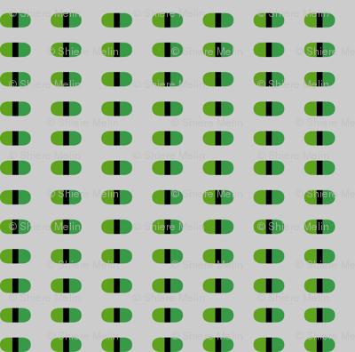 Capsules | Green on light gray