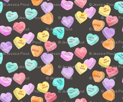 valentines day heart candy - conversation hearts on dark grey