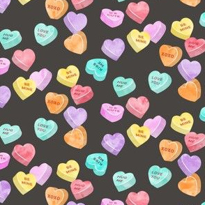valentines day heart candy - conversation hearts on dark grey