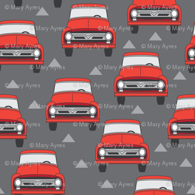 vintage red trucks on charcoal