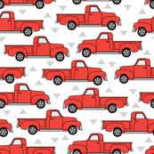 vintage red trucks on white